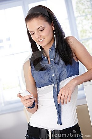 Young female using mobile phone