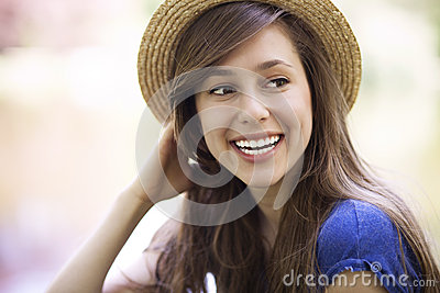 Young female wearing straw hat