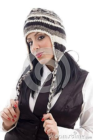 Young female wearing woolen cap