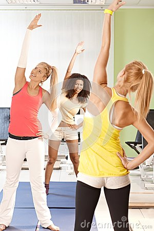 Young females exercising at the gym