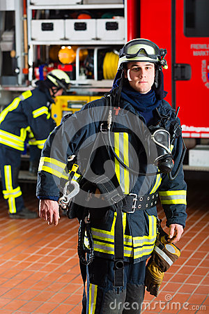 Free Young Fireman In Uniform In Front Of Firetruck Stock Photos - 30194103