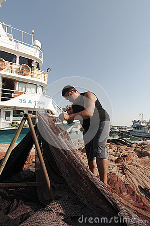 Young fisherman and fish nets Editorial Photography