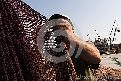 Young fisherman and fish nets Editorial Photo