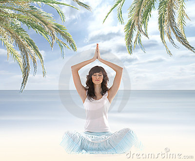 A young and fit brunette meditating