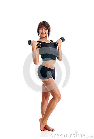 A young and fit brunette woman holding dumbbells