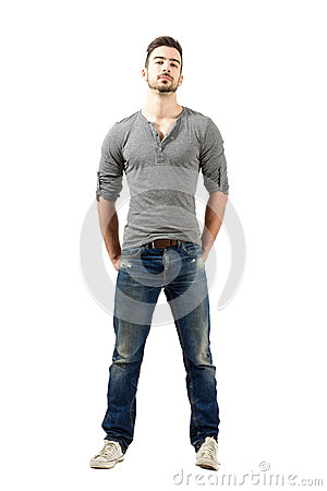 Free Young Fit Man In V-neck T-shirt, Torn Jeans And Sneakers Royalty Free Stock Photography - 46374957