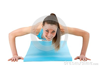 Young fit woman doing push ups.