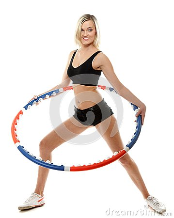 Young fitness woman with hula hoop isolated