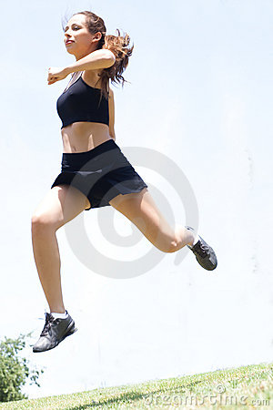 Young fitness woman jumping