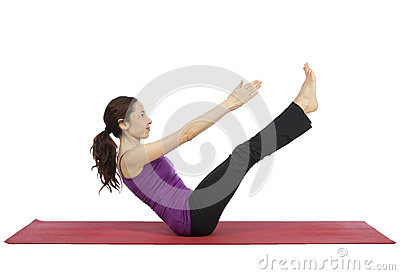 Young fitness woman training her ab muscles Stock Photo