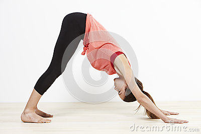 Young flexible woman doing yoga Stock Photo