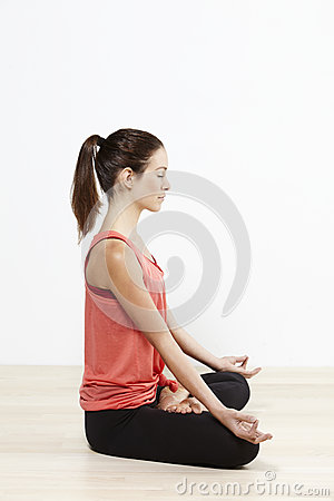 Young flexible woman doing yoga, eyes closed Stock Photo