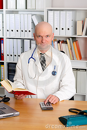 Free Young Friendly Family Doctor With Book And Pocket Calculator Stock Photo - 53916270