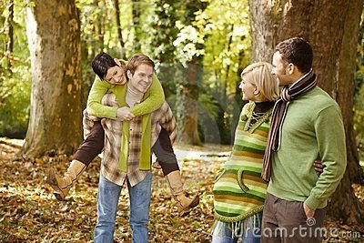 Young friends having fun in autumn park