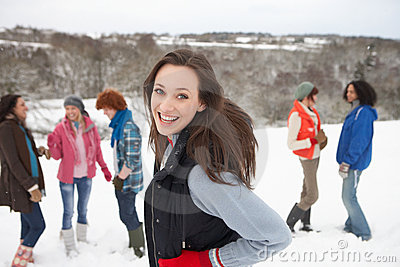 Young Friends Having Fun In Snow