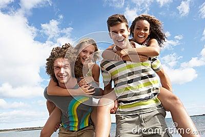 Young Friends Having Fun On Summer Beach