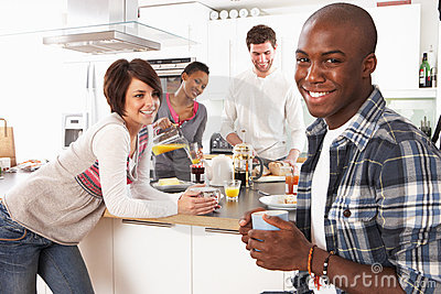 Young Friends Preparing Breakfast In Kitchen