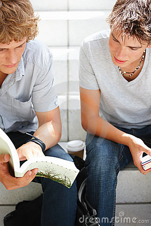 Young friends reading book