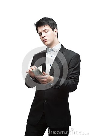 Young funny business man holding money
