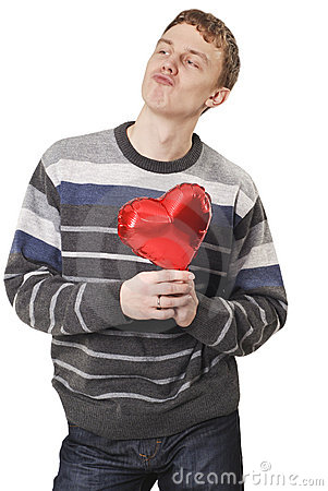 Young funny handsome man with red heart balloon
