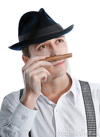 Young gangster man sniffing a cigar