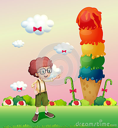 A young gentleman standing near the giant icecream