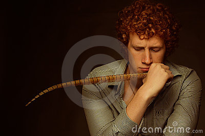 Young ginger poet pushkin with feather