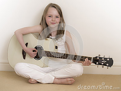 Young Girl on a Acoustic Guitar 2
