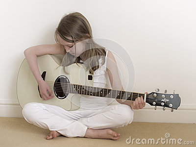 Young Girl on a Acoustic Guitar