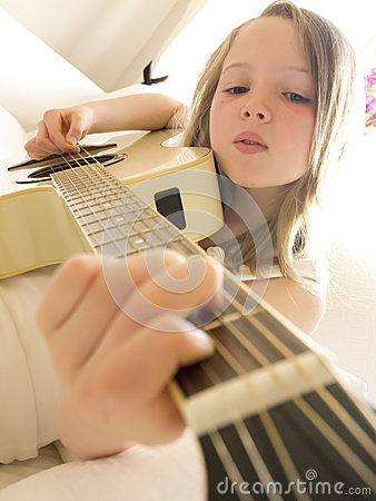 Young Girl on a Acoustic Guitar 5