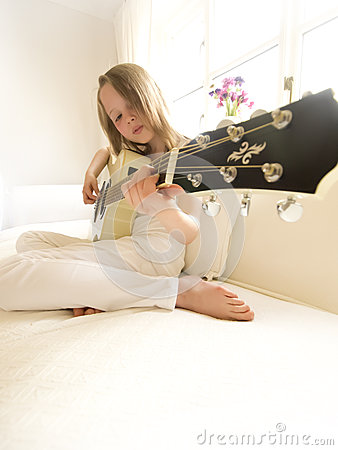 Young Girl on a Acoustic Guitar 7