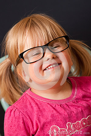 Young girl with adult glasses