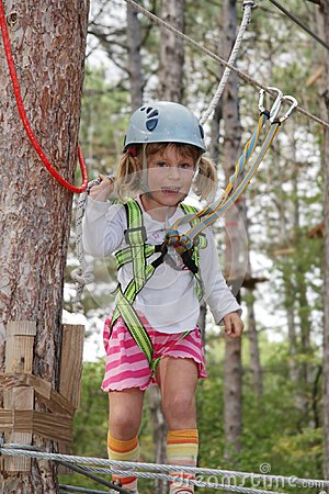 Young girl in adventure park