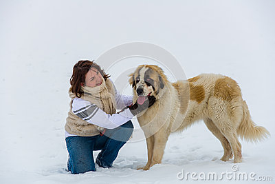 Young girl affection moment with her shepherd dog in the winter time