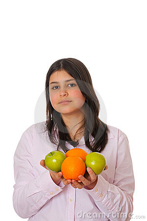 Young girl with apples and oranges