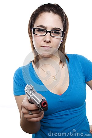Young girl with attitude and holding gun