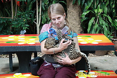Young girl with a baby leopard