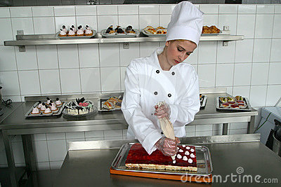 Young girl baking cakes
