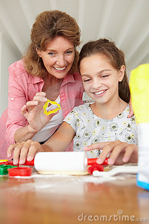 Young girl baking with grandmother