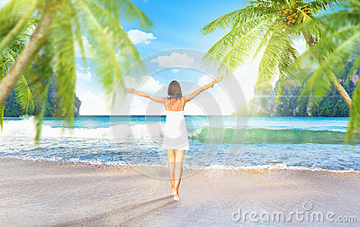 Young girl on the beach with palm trees