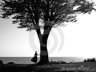 Young girl with a beautiful tree