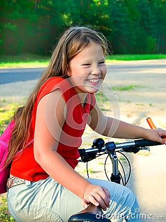 Young girl and bike