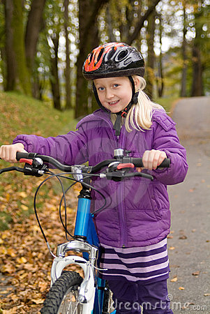 Young girl with a bike