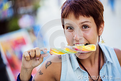 Young girl bitting an ice lolly