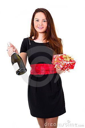 Young girl in black dress holding a gift