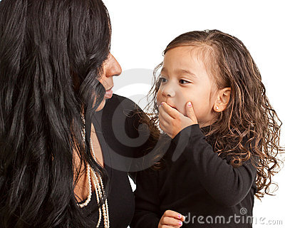 Young girl blows a kiss to her Mother