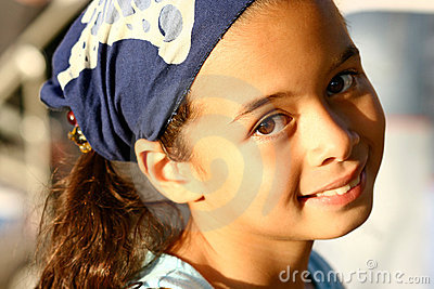 A young girl in blue bandanna