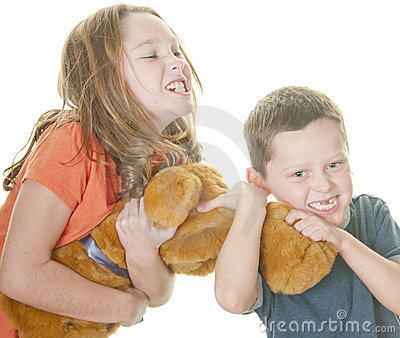 Young girl and boy fighting over bear