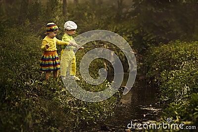 Young girl and boy fishing