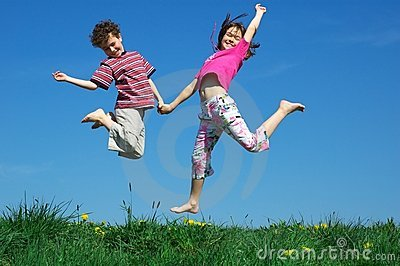 Young girl and boy  jumping